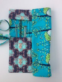 A beautiful needle roll which will hold lots of needles right up to the long 14 ones. There are 14 needle pockets, 6 large and 8 smaller Knitting Needles, All Things, Buy And Sell, Pockets, Sewing, Fabric, Handmade, Stuff To Buy, Beautiful