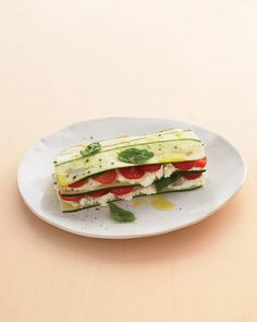 """Zucchini lasagna with farmer cheese.There's no cooking required for this """"lasagna"""" made of garden-fresh zucchini and tomatoes, layered with creamy farmer cheese and basil leaves. Cheese Recipes, Raw Food Recipes, Vegetable Recipes, Vegetarian Recipes, Cooking Recipes, Healthy Recipes, Cooking Kale, Vegan Food, Dinner Recipes"""