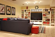 Basement Makeover - shelves around t.v - excellent storage for games, dvds, cds, etc