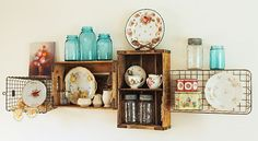 wall shelves made from vintage soda crates and wire baskets