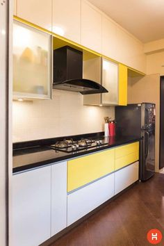 A modern kitchen with white and bright yellow cabinets! // modern small kitchen design layout, interiors and shelves Kitchen Modular, Modern Kitchen Cabinets, Smart Kitchen, Kitchen Furniture, Kitchen Island, Kitchen Small, Kitchen Pantry, Modular Kitchen Indian, Indian Kitchen