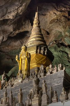 Buddhas in Pak Ou Cave in Laos  - Explore the World with Travel Nerd Nici, one Country at a Time. http://travelnerdnici.com