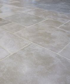 Machalot antique limestone tiles - flooring. Beige and grey tones with a classically aged surface. A favourite for modern and old homes. Visit our Newbury Berkshire showroom.  http://www.naturalstoneconsulting.co.uk/machalot-antiqued-flagstones