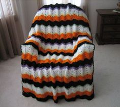 This Striped Halloween Crochet Afghan Pattern is perfect for those cold, autumn days! Use this to keep the kids warm between houses while trick-or-treating! Crochet Afghans, Baby Blanket Crochet, Free Crochet, Easy Crochet, Knit Crochet, Ravelry Crochet, Crochet Cushions, Baby Afghans, Crochet Blankets