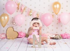 One year old posing for pink and gold themed Baby Cake Smash Photo by Brandie Narola Photography