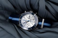 """In the fight against pollution of the oceans, Breitling provides advice and assistance to the organization """"Ocean Conservancy"""". The limited Superocean Heritage II Chronograph 44 (ref. A133131A1G1W1) therefore comes with a strap and a box made entirely from recycled ocean waste. Ocean Conservancy, Breitling Superocean Heritage, Breitling Watches, Oceans, Chronograph, Advice, Organization, Luxury, Box"""
