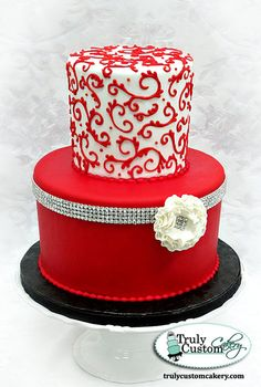 """Red piping on white and then a strip of bling makes this cake striking and elegant! Made for a client's 30th Birthday. Love the ruffled fantasy flower with """"bling"""" in the center. And I have to admit, I'm very pleased with myself as my former business partner did most of the piping and I did the piping all by myself! lol I was giddy cause it turned out so well. (It's the little things)"""