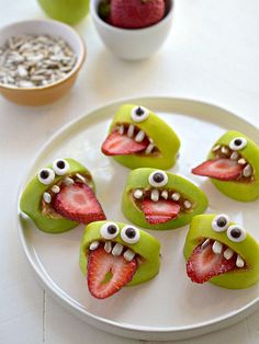 17 Creepy-Cute Treats to Make for Halloween | GREEN MONSTERS | Finally, a healthy Halloween party snack that is still sufficiently creepy: green apple wedges with strawberry tongues, sunflower seed teeth and a spread of peanut butter.