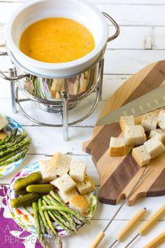 Pesto Cheese Fondue Recipes | ASpicyPerspective.com #fondue #cheese #pesto #delallo