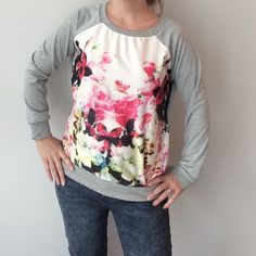 Floral sweatshirt w/baseball style sleeves Preowned and in excellent condition. Size medium- fits like a small medium in my opinion. Measurements: underarm to underarm flat across is approximately 21 inches. Back of neck to bottom of hem is approximately 22 1/2 inches. No material tag- front panel is a polyester like material and the rest is probably a cotton/polyester/spandex blend. Like a lightweight sweatshirt without the fuzzy inside. If you need more info please ask! Sweaters Crew…