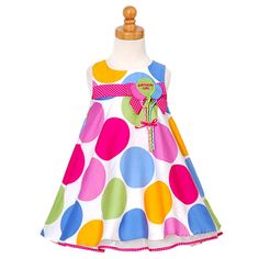 "A fabulous birthday dress for your little girl by Bonnie Jean. Pastel colored large polka dot waistline dress with polka dot sash and balloons with the words ""Birthday Girl"" embroidered on them. Matching bloomers. Please note: The balloons come with the """
