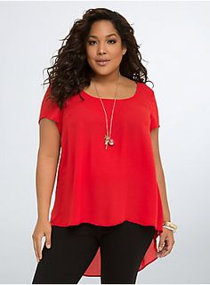 """<p>A red-hot top for a hot mama. Made with georgette that keeps a cool head no matter what. With a flowy fit that catches the breeze (thanks sharkbite hem). Held in place by a subtle back strap. A seamed back inset turns heads.</p><p></p><p><b>Model is 5'10"""", size 1</b></p><ul><li>Size 1 measures 29 1/2"""" from shoulder</li><li>Polyester</li><li>Wash cold, dry low</li><li>Imported plus size top</li></ul>"""