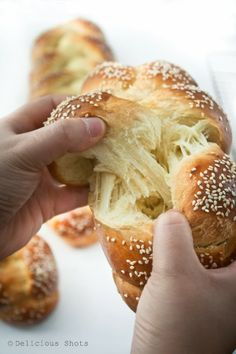Challah Bread - 7-1/2 to 8 cups of flour, 1-1/4 cups cold water, 3 whole eggs, 6 egg yolks, 8 teaspoons honey, 3 tablespoons yeast, 4 teaspoons salt, 4-1/2 tablespoons sugar,  5-1/2 tablespoons oil, sesame seeds for sprinkling. (Original recipe is in grams)
