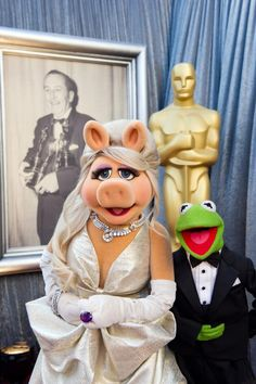 "Miss Piggy & Kermit backstage at the 84th Oscars after the Academy Award presentation for Best Song (""Man or Muppet"") by songwriter Bret MacKenzie! Unfortunately, Bret was forced to turn-over the award to Miss Piggy backstage..."