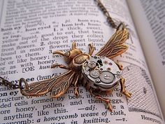 Funky victorian style bee necklace, love this.