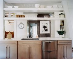 Exposed shelving in an open kitchen