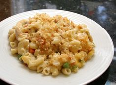 Try this tuna casserole recipe with macaroni and cheese, bell pepper, onion, and cream of mushroom soup for your family dinner.