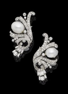 A pair of cultured pearl and diamond earclips Each 12.2mm cultured pearl within a stylised floral and foliate surround, set throughout with cushion-shaped, old brilliant, baguette, single and rose-cut diamonds, diamonds approx. 2.70cts total, length 4.5cm