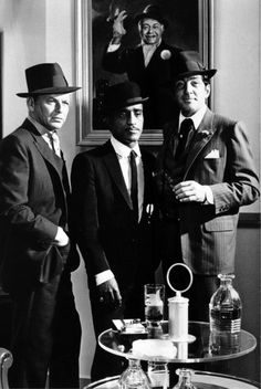 Frank Sinatra, Sammy Davis Jr., and Dean Martin - Photographed by Cecil Beaton  Often, when one of the members was scheduled to give a performance, the rest of the Pack would show up for an impromptu show, causing much excitement among audiences, resulting in return visits. They sold out almost all of their appearances, and people would come pouring into Las Vegas, sometimes sleeping in cars and hotel lobbies when they could not find rooms, just to be part of the Rat Pack entertainment…