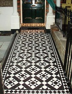 Monochrome Victorian tiles often seen in pathways outdoors but I would like them in my hall
