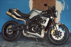 """London's Ace Cafe will forever be associated with greasy rockers, old Brit iron and the post-War """"Ton-Up Boys"""". But this venerable institution has now put its name to a very contemporary café racer—based on the Triumph Street Triple R. A short run of ten 675CR Street Triple Specials will be built by Jack Lilley, the…"""