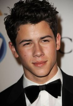 I've never been a big Jonas fan, but I'm sitting here watching Camp Rock 2 and looking at how adorable Nick Jonas is...