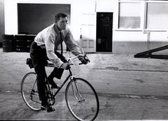 Robert Mitchum rides a bike.