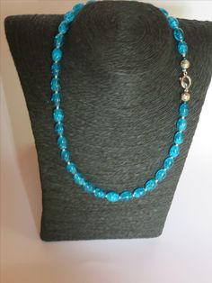 Turqoise glass foil crackle beads with silver plated clasp and beads.