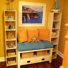 DIY project! Made from an old coffee table and cheap Walmart book shelves. Just added some paint and a little wood trim and bam, you have a cozy little nook! :D