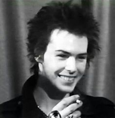 Sid Vicious cheesin' hard.