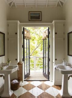 Checker painted floors and french doors in this charming bathroom. That art above the doorway is everything. House Tour: Historic Beauty in Mill Valley - Design Chic. Bathroom Pictures, Painted Floors, Beautiful Bathrooms, Bathroom Inspiration, Cheap Home Decor, Home Decor Accessories, House Tours, Home Remodeling, Bathroom Remodeling