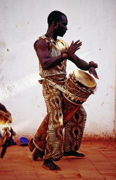Angolan hand drummer (Fortress of Sao Miguel 1576 Africa) note the legs/stand cut into the long drum...