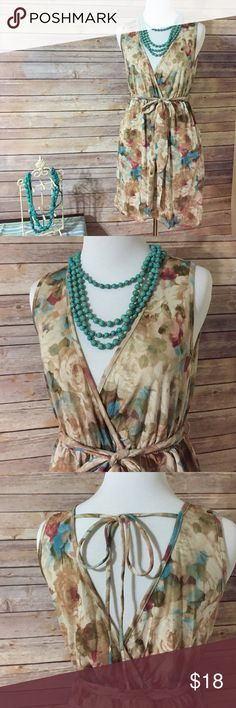 """Watercolor print sleeveless dress This is so pretty!  New without tags, deep v front and back, matching fabric tie belt covers an elastic waistband,faux wrap and pockets!  100% polyester, Sz medium. Bust measures 32"""", length is 31"""".  Necklace not included or available. Dresses"""