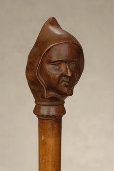 A very good hooded monk nut-cracker cane : Lot 66 Walking Sticks And Canes, Walking Canes, Cannes, Nut Cracker, Cornices, Stick Art, Antique Bottles, Woodcarving, Caricatures