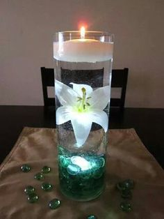 Floating candle and immersed flower center piece.