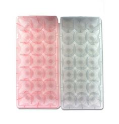 """2 Pack Ice Cube Trays by Kole Imports. $5.95. Durable Plastic. This set of 2 ice cube trays have a fun mold which will give ice a diamond style design. Made with durable plastic and come in various transparent colors including green, yellow and pink. Trays are packaged on a header card with poly bag. They measure 8 1/2"""" x 3 3/4"""". Cubes measure 1"""" x 1"""". Colors: green,pink."""