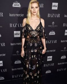 See @NicolaAnnePeltz wearing an Alexander McQueen AW16 Nightflower embroidered chiffon & Sarabande lace gown with a satin knuckle box clutch to the #BAZAARicons party. #AlexanderMcQueen #SeenInMcQueen #NYFW