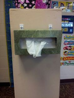 I used Command hooks to attach the tissues to. Easier access for the children and it also frees up counter space.