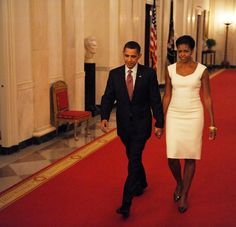 President Barack Obama walks with First Lady Michelle Obama to host an event celebrating classical music in the East Room of the White House on November 4, 2009 in Washington, DC.