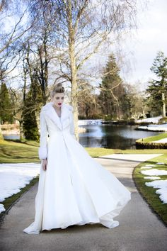 Anastasia coat with detachable fur collar and cuffs with pretty sparkly buttons. Available to hire or buy at Georgina Pimm Bridal.