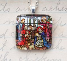A Stained Glass Nativity Scene pendant necklace.