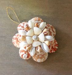 A gorgeous addition to your Christmas Tree.  This Seashell Christmas Ornament has Seashells covering this compact size mirror.  All Natural color.  A Beautiful