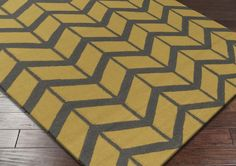 Surya Fallon FAL-1090 Area Rug From delicate lattice patterns to boldly colored chevron patterns the Fallon Collection makes a statement in flat weave; from creator Jill Rosenwald known for her beautifully colored, hand-made ceramics.