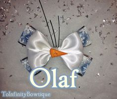 Look how cute! Olaf Frozen inspired Hair Bow by ToInfinityBowtique on Etsy, $9.50