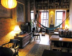 The PERFECT library/study room--Book loft (w/ladder), rows of bookcases (organized either by author or genre), and chairs/tables/couches as a study place with architectural detail and support to hang an eno hammock by the window.