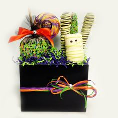 Small Spoktacular Basket Includes 1 apple of your choice, 1 dizzy pop, 3 gourmet pretzels & 1 mummy marshmallow arranged in a black tote box. $32.00