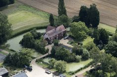 Cotton Hall moated house near Stowmarket in Suffolk - aerial view | by John D F
