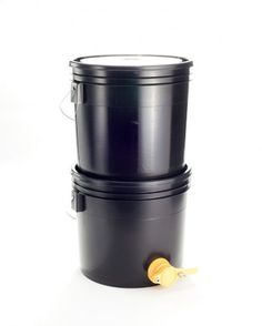 This is our handy bucket strainer system for use extracting honey, via the crush-and-strain method. To use: simply place honeycombs into the top bucket (which is lined with a screened bag), smash up t Hives And Honey, My Honey, Honey Bees, Top Bar Hive, Raising Bees, Bee House, I Love Bees, Garden Animals, Hobby Farms