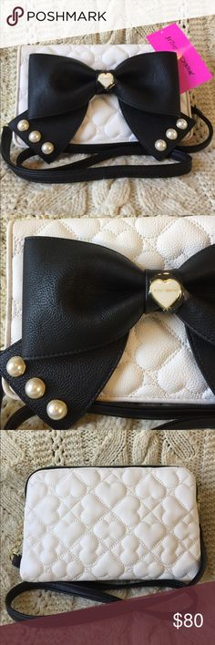 "Betsey Johnson crossbody bow wallet purse, NWT! Super cute Betsey Johnson crossbody bow wallet purse.  Cream and black with pearl details.  Measures 9.26""Lx5.25""Hx2.5""W strap measures 47"".  NWT! Betsey Johnson Bags Crossbody Bags"