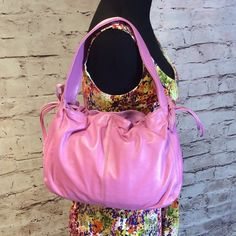 LIZ CLAIBORNE PINK LEATHER PURSE Beautiful pink leather purse that's NWOT. Never used, perfect condition Liz Claiborne Bags Shoulder Bags